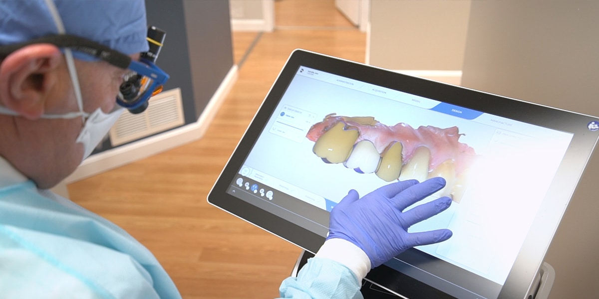 dentist viewing digital x-ray on touch screen monitor